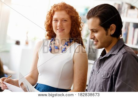 Two young people in office