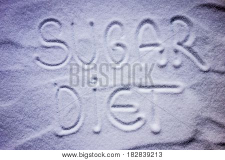 Sugar diet writing text with sugar background