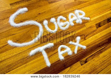 Sugar tax sign with wooden table background