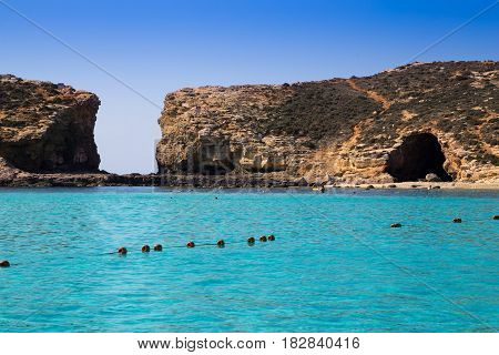 Comino Malta - Beautiful azure sea water at the famous Blue Lagoon on the island of Comino with clear blue sky on a sunny summer day