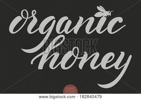 Hand drawn lettering - Organic honey. Elegant modern handwritten calligraphy. Vector Ink illustration. Typography poster on dark background. For cards, invitations, prints etc.