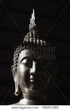 Black and white image Buddha statue of Thailand