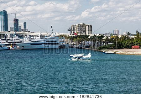 A Seaplane by Yachts in Biscayne Bay