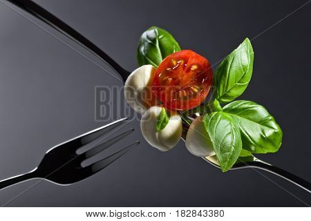 Mini Mozzarella With Tomato Cherry And Green Basil .
