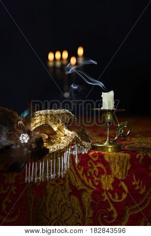 Candlestick And Venetian Mask