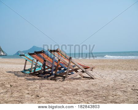 Sandy beach with chaise lounges