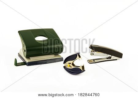 On a light background punch stapler and anti-stapler