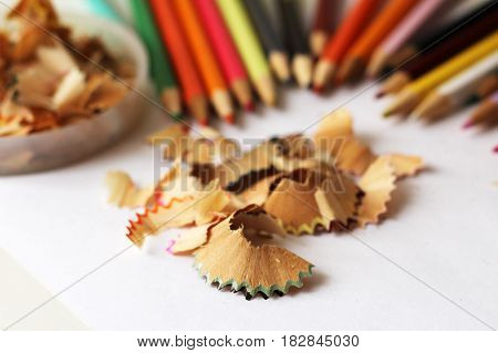 Colored pencils and sawdust school supplies bright