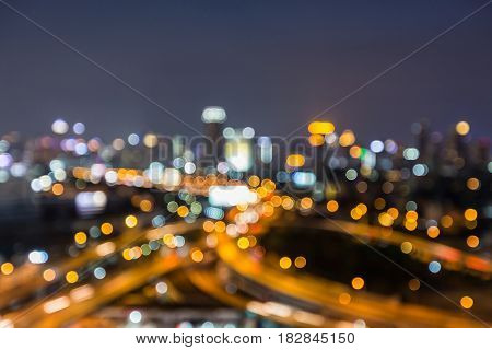 Blurred bokeh light highway intersection aearial view abstract background