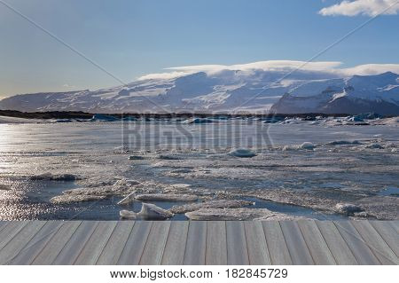 Opening wooden floor Natural winter season lake with mountain background Iceland