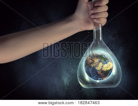 The world in test tube . Mixed media