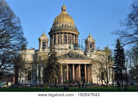St. Isaac's Cathedral and walking people on a Sunny day in St. Petersburg