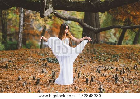 Beautiful wiccan girl dancing in the mystical forest