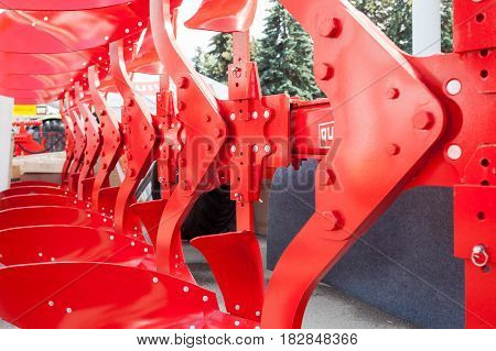 New red agricultural equipment: plow. Close up
