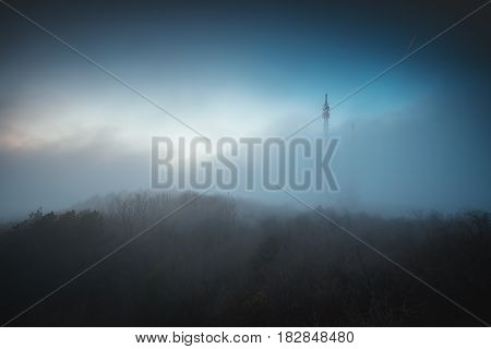 Misty Fog Over Connection And Radio Tower In The Mountain