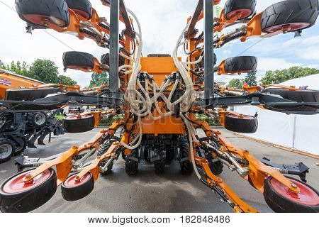 New orange pneumatic agricultural seeder close up