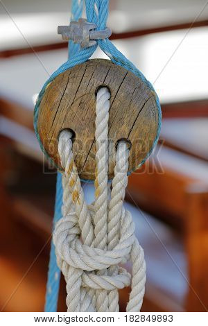 Wooden naval block to tie ropes to sailboats