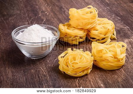Tagliatelle And Flour On The Table