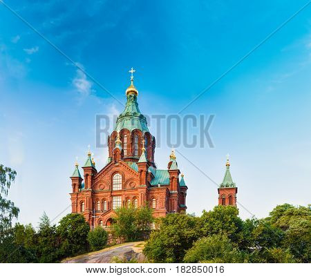 Helsinki, Finland. Uspenski Cathedral On Hill At Summer Sunny Day. Red Church - Tourist Destination In Finnish Capital. Eastern Orthodox Cathedral Dedicated To Dormition Of The Theotokos Virgin Mary