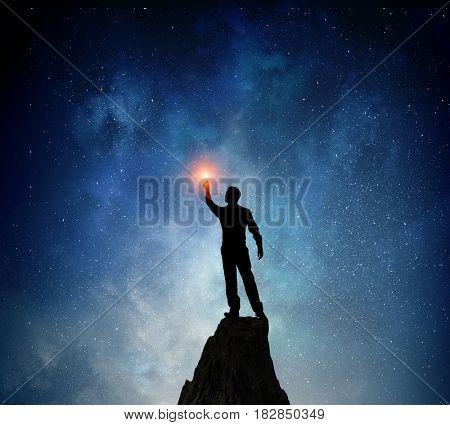 Businessman against starry sky . Mixed media . Mixed media