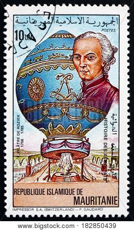 MAURITANIA - CIRCA 1983: a stamp printed in the Mauritania shows F. Pilatre de Rozier and his baloon was a French chemistry and physics teacher and one of the first pioneers of aviation circa 1983