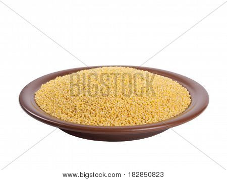 Millet heap on plate isolated on white backgrpound high angle view