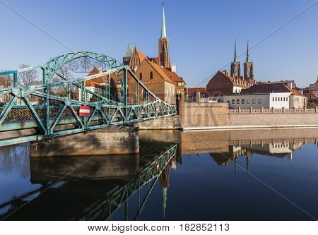 Tumski Bridge and Wroclaw Collegiate Church Wroclaw Lower Silesian Poland.