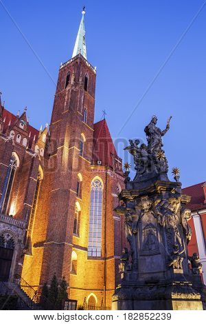Wroclaw Collegiate Church and fountain at night Wroclaw Lower Silesian Poland.