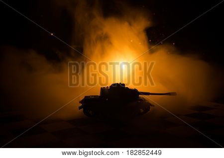 Tanks In The Conflict Zone. The War In The Countryside. Tank Silhouette At Night. Battle Scene.
