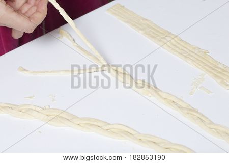Strips Of Puff Pastry, Woven Into A Pigtail. Preparation Of Baking.