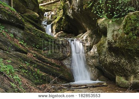Waterfall on stream in the Carpathian mountains, rocky streambed