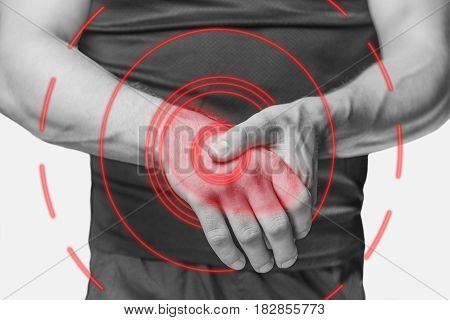 Carpal syndrome in a male wrist. Monochrome image isolated on a white background. Pain area of red color.