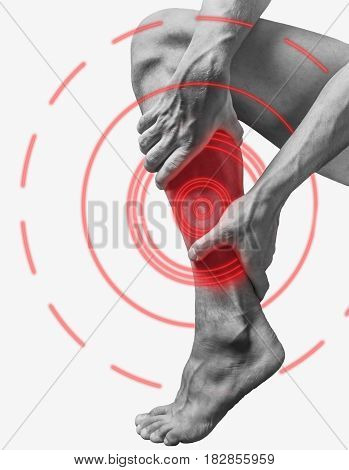 Acute pain in a male calf muscle. Monochrome image isolated on a white background. Pain area of red color.