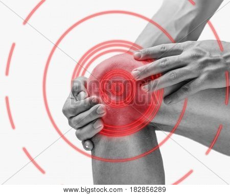 Acute pain in a knee joint side view. Monochrome image isolated on a white background. Pain area of red color.