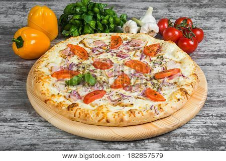 Meat Pizza With Bacon, Chicken, Tomatoes, With Rosemary And Spices On A Light Wooden Background. Ita