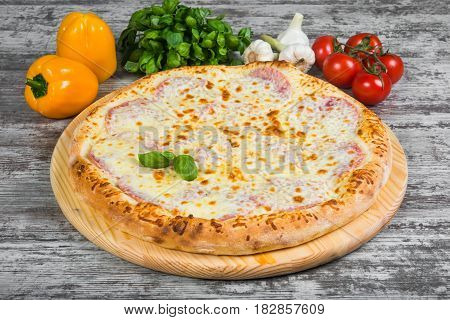 Pizza With Ham Under Cheese, With Rosemary And Spices On A Light Wooden Background. Italian Pizza On