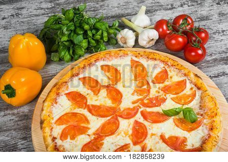 Pizza With Tomatoes, With Rosemary And Spices On A Light Wooden Background. Italian Pizza On A Backg