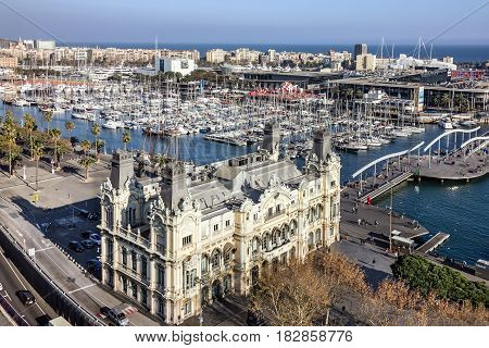 Barcelona, Spain - April 15, 2017: Port Vell embankment panoramic view. Building of port administration