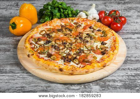 Pizza With Seafood, With Rosemary And Spices On A Light Wooden Background. Italian Pizza On A Backgr