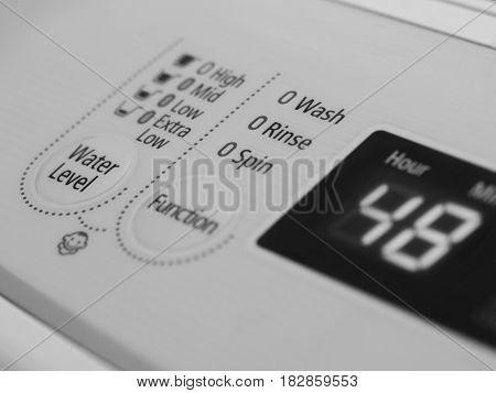 CLOSE UP SHOT OF WASHING MACHINE LCD INDICATOR
