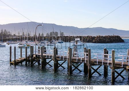 Pier extending into Wollongong Harbour, Australia, to allow access to boats