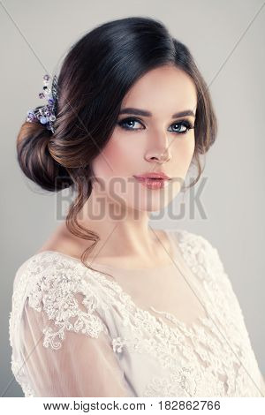 Young Woman Fashion Model with Beautiful Hairstyle and Makeup