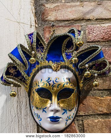 Jolly type Venetian mask suspended on the wall