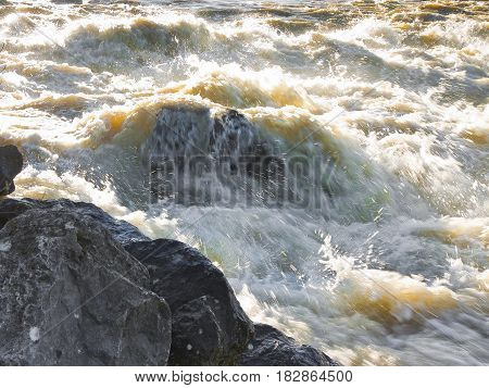 Rushing waters of a swollen river during the rainy season