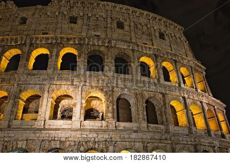 Colosseum at night- the main tourist attractions of Rome, Italy. Ancient Rome Ruins of Roman Civilization
