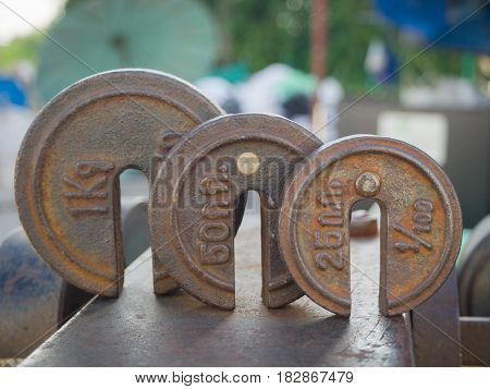 Body parts of weight scale and rust on surface.