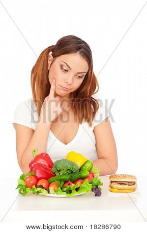 pensive woman choosing burger or vegetables. isolated on white background