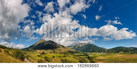 Panoramic summer view on the village of Ancelle and the Autane mountain peaks Champsaur Valley Hautes Alpes Southern French Alps France