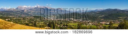 Panoramic summer view of the city of Gap in the Hautes Alpes with surrounding mountains and peaks. Southern French Alps Paca region France