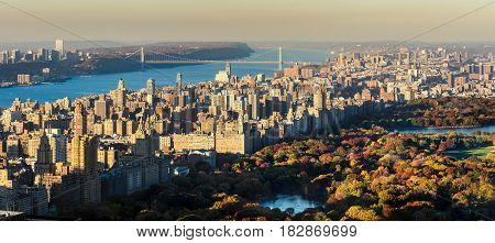 Panoramic elevated view of Central Park Upper West Side and the George Washington Bridge with Hudson River in Fall. Manhattan New York CIty